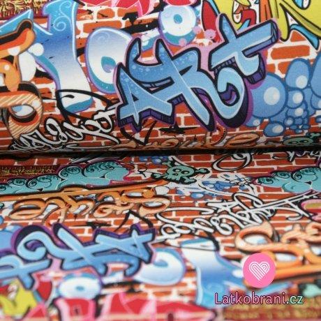 Teplákovina grafiti písma na cihlové zdi