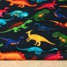 Teplákovina dinosauři barevní na tmavě modré