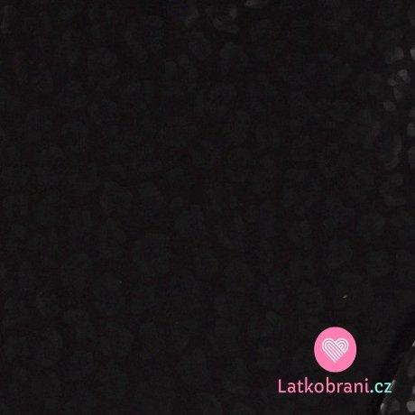 Úplet strukturovaný ztracenými abstraktními květy černé na černé