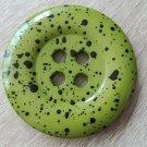 Knoflík mega velký zelený s černými cákanci