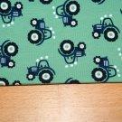 Úplet traktory modré na mátovo-zeleném podkladu