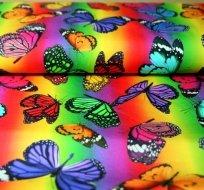 Digitisk úplet motýlci na duhovém podkladu