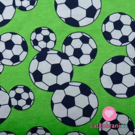 Bavlněný úplet fotbalové míče na zelené