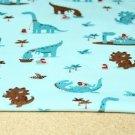Úplet dinosaurus hnědý, pračlověk na modré