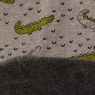 Warmkeeper krokodýl na šedé melé