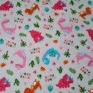 Bavlněný úplet růžoví dinosauři na šedé