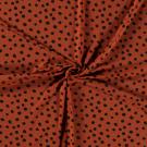Úplet nepravidelné černé puntíky na cihlové