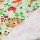 Teplákovina POČESANÁ ježek s lesními plody na smaragdové