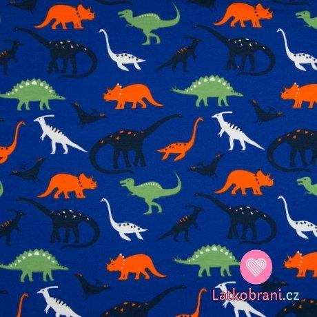 Teplákovina potisk barevní dinosauři na královsky modré
