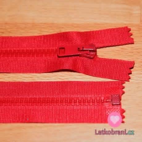 Zip kostěný dělitelný 55cm červená