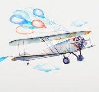 Panel letadlo s balónky na modré obloze