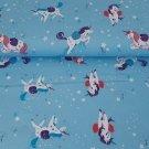 Bavlněné plátno kouzelní jednorožci na modré