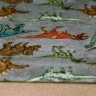 Úplet dinosauři na šedém melé