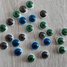 Knoflík oko modré