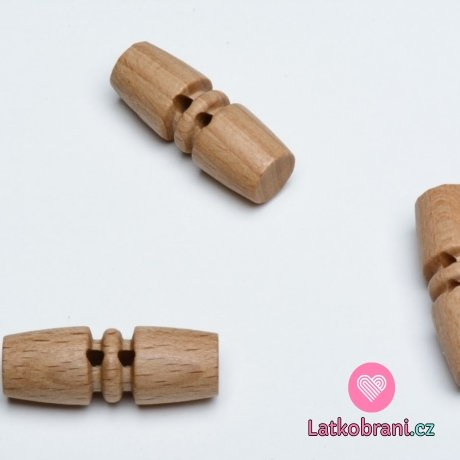 Knoflík oválný, dřevěný s ozdobou uprostřed