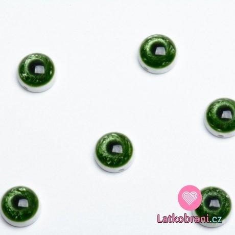 Knoflík oko zelené